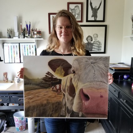 Me holding cow drawing